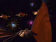 Schiffe der Galor-Klasse machen Feuerwerk bei Leuchtschiff