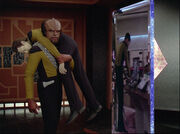 Worf carries Data through portal