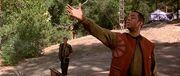 Geordi La Forge mimics Zefram Cochrane's statue