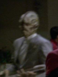 ... as the alien Quantum Café bartender