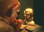 Quark prays, The Emperor's New Cloak