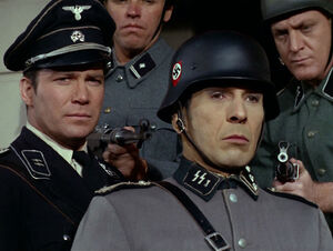 Spock and Kirk are discovered by the Nazis