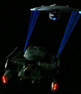 Federation tug towing USS Fredrickson