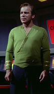 Kirk wearing green wraparound tunic, sleeve rank