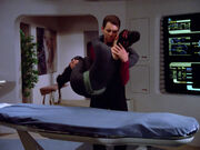 Riker delivers Troi to sickbay