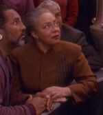 Bajoran woman watching the emissary