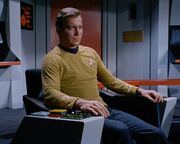 Kirk in Enterprise command chair