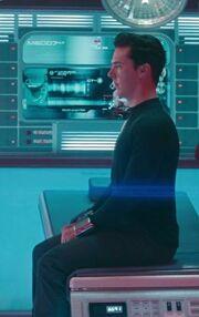 Khan in handcuffs