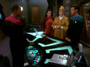 Sisko, Kira, Winn, and Bashir discuss Bareil