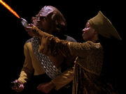 Guinan beats Worf at phaser range