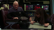 Picard and Troi on bridge after decompression