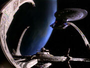 USS Enterprise-D docked at DS9 while orbiting Bajor