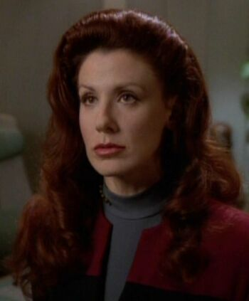 "Female Q on the <a href=""/wiki/USS_Voyager"" title=""USS Voyager"">USS <i>Voyager</i></a>"