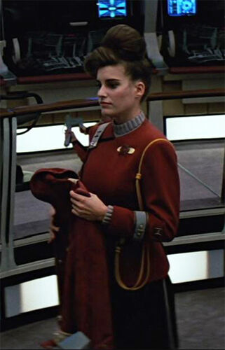 "...as the <a href=""/wiki/USS_Enterprise-A_yeoman_1"" title=""USS Enterprise-A yeoman 1"" class=""mw-redirect"">captain's yeoman</a> (1989)"
