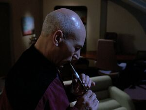 Picard playing Ressikan Flute