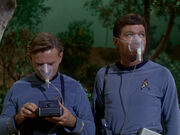 Leonard McCoy and Carl Jaeger wearing breathing masks