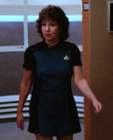 Female science division ensign at turbolift, 2364