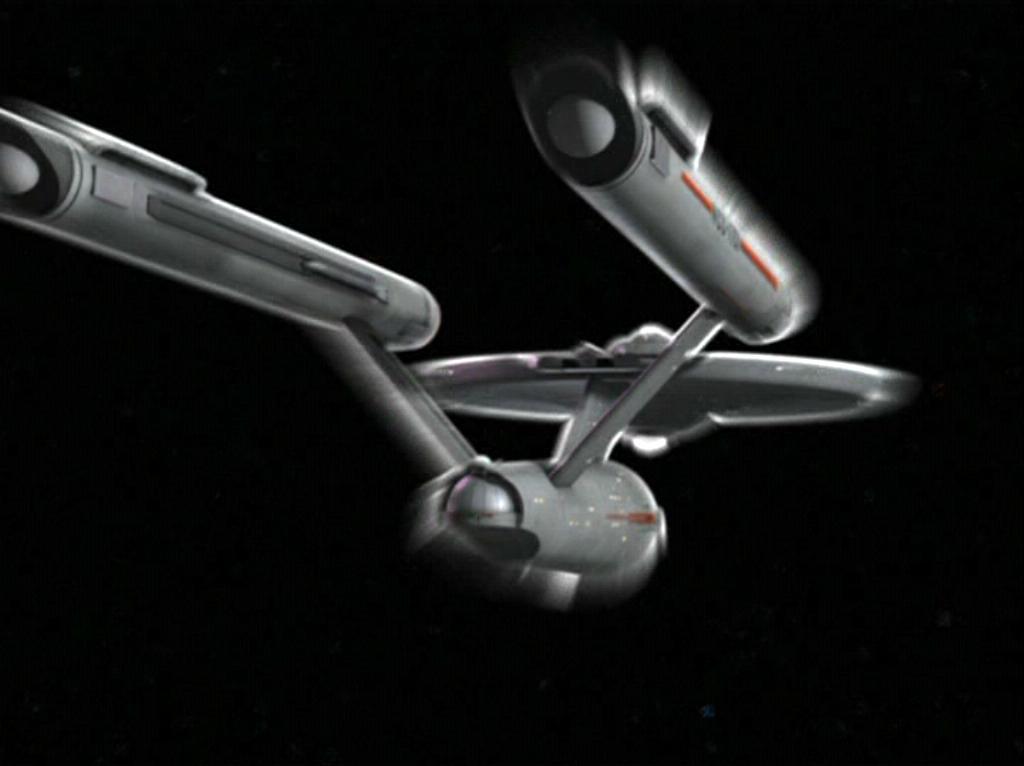 USS Enterprise hurled through space