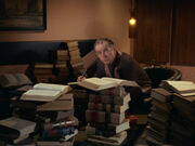 Cogley surrounded by books