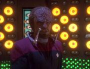 Worf wearing virtual control device