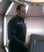 Crewman at transporter bay in 2151