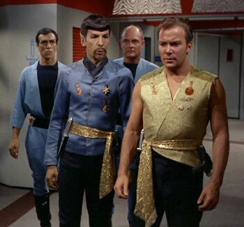 "Spock and <a href=""/wiki/James_T._Kirk"" title=""James T. Kirk"">James T. Kirk</a> with guards in <a href=""/wiki/2267"" title=""2267"">2267</a>."