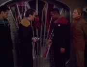 Bashir, O'Brien, Sisko, and Odo in front of Quark's