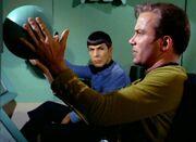 Kirk adjusts automatic scanner