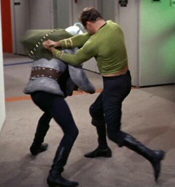 "Thelev in close combat with <a href=""/wiki/James_T._Kirk"" title=""James T. Kirk"">James T. Kirk</a>"