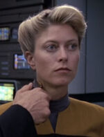 Female operations officer in sickbay, 2376
