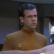 Bajoran medical officer assisting Tahna Los