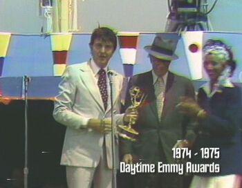 """Scheimer accepts the Daytime Emmy for """"Best Children's Program"""""""