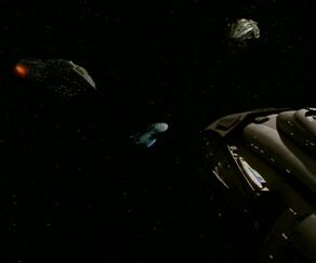 Kazon carriers surround Voyager.jpg