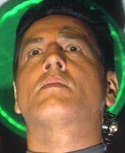 Chakotay wearing a neuro-transceiver