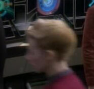 Human female starfleet officer in Ops