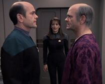 Deanna Troi with the Doctor and Lewis Zimmerman