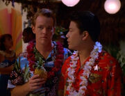 Kim and Paris wearing Hawaiian shirts and leis