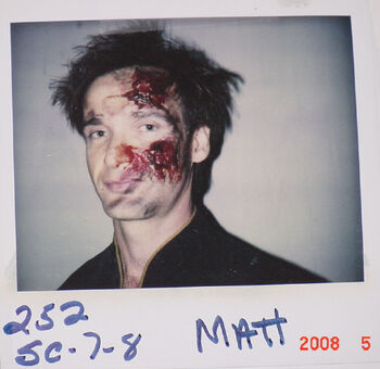 "Goodrich on a makeup continuity polaroid from ""Descent"""