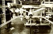 Star Trek Phase II Enterprise studio in test set-up with abandoned spacedock model