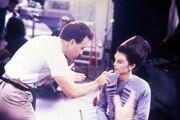 Doug Drexler adjusting the makeup on actress Juliana Donald