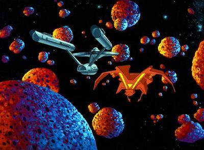 Enterprise und ein Schiff der Orioner