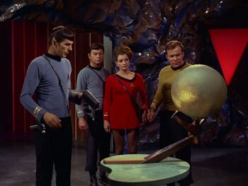 The requested <i>Enterprise</i> landing party meet Sargon's essence (in his sphere, right)