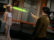 Deela dodges a phaser beam