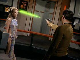 Deela dodges a phaser beam