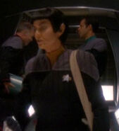 Female Vulcan DS9 officer at airlock