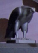 Raptor sculpture on Mordan IV