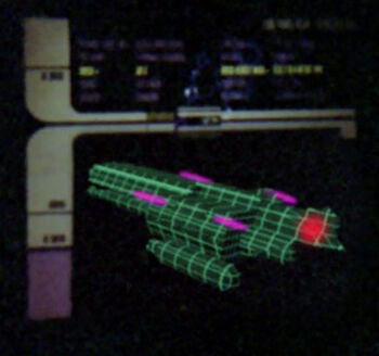 A graphic of the <i>Erstwhile</i> showing the location of its bridge (red) and laser array (pink)