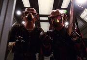 Krem and Muk wearing gas masks
