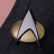 Starfleet combadge, 2364