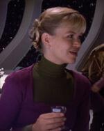 Female science officer off duty in ten forward